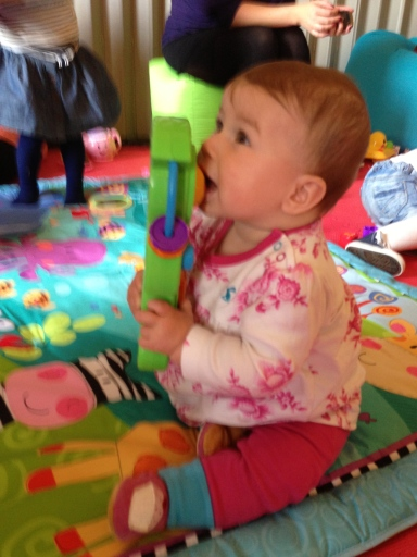 Claudia enjoyed a good play and chew of the Fisher-Price Laugh & Learn Jam & Learn Guitar