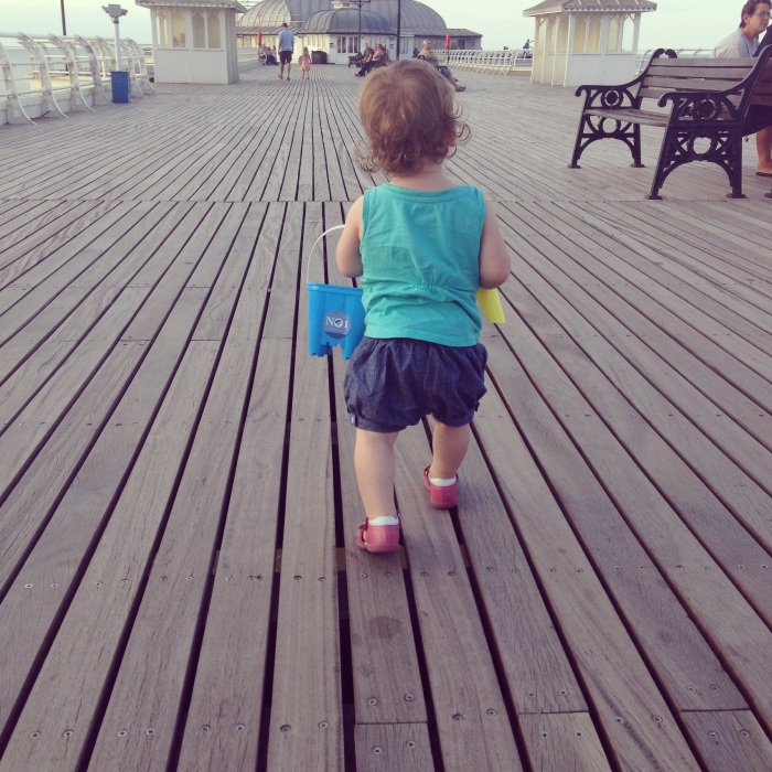 Heading down the pier, bucket and spade in hand, on a British seaside holiday